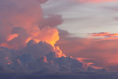 Clouds and skies. Red and purple sunset, sun rays between clouds in thailand Royalty Free Stock Photography