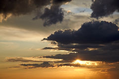 Clouds in the sky. Picture showing a clowdy sky infront of sunset Royalty Free Stock Image