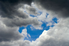 Clouds & sky. Storm clouds parting to reveal a blue sky Royalty Free Stock Photo