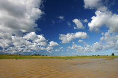 Clouds on sky. Clouds on deep blue sky with water Royalty Free Stock Photos