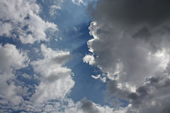Clouds in the sky. Cumulus clouds in the sky before the sun Royalty Free Stock Photos