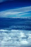 Clouds and sky. White clouds and blue sky till the horizon Royalty Free Stock Photo