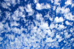 Clouds and sky. A deep blue sky with vaporous clouds after rain Stock Photos