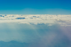 Clouds and sky from above. As seen through window of an aircraft Stock Image