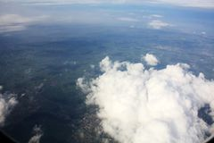 Clouds sky above the earth from airplane. In sunny day royalty free stock images