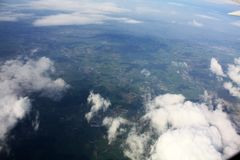 Clouds sky above the earth from airplane. In sunny day royalty free stock photos