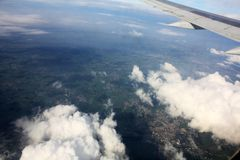 Clouds sky above the earth from airplane. In sunny day royalty free stock image