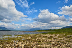 Clouds in the sky above lake. Stock Images