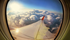 Clouds and sky as seen through window of  aircraft Stock Images