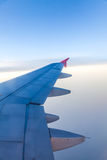 Clouds and sky as seen through window of an aircraft Stock Photo