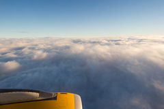 Clouds and sky as seen through window of an aircraft/airplane.  royalty free stock photos