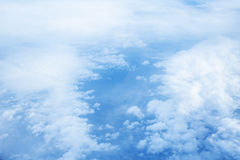 Clouds and sky as seen through window of an aircraft. Stock Images