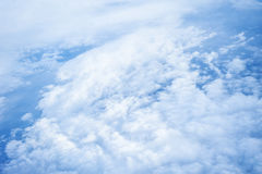 Clouds and sky as seen through window of an aircraft. Stock Photo