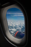 Clouds and sky as seen through window of an aircraft Stock Images