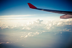 Clouds and sky as seen through window of an aircraft Royalty Free Stock Image