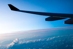Clouds and sky as seen through window of an aircraft Royalty Free Stock Images