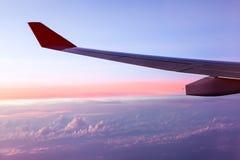Clouds and sky as seen through window of an aircraft Stock Photos