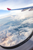 Clouds and sky as seen through window of an aircraft Stock Photos