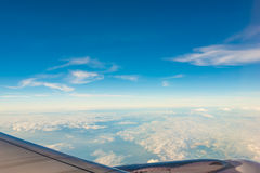 Clouds and sky as seen through window of an airplane Stock Photography