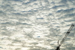 Clouds and sky as well as construction cranes Royalty Free Stock Photo