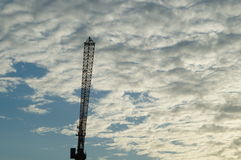 Clouds and sky as well as construction cranes Royalty Free Stock Photos