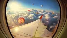 Clouds ,sky and Balloons as seen through window of  aircraft Stock Images