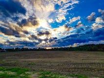 Farm field under blue skies stock photography