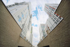 Clouds in sky and buildings of residential complex Royalty Free Stock Photography