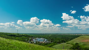 Clouds sky city beautiful sunny day nature hills mountains travel the country building timelapse stock video footage