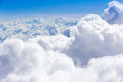 Clouds and sky. Cumulous clouds at about 35,000 feet Stock Photo