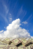 Clouds in the sky with dollars. White clouds in the sky with dollars royalty free stock photography