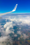 Clouds, sky and earth in window of aircraft Stock Photos