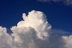 Clouds in the sky. Fluffy clouds on a blue sky royalty free stock photo