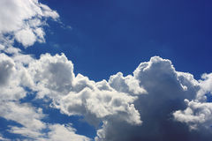 Clouds in the sky. Fluffy clouds on a blue sky stock image