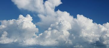 Clouds in sky. Fluffy white clouds in a blue sky Royalty Free Stock Photography
