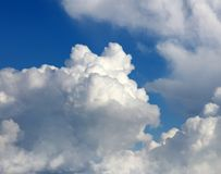 Clouds in sky. Fluffy white clouds in a blue sky Royalty Free Stock Image