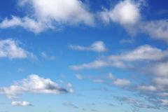 Clouds in sky. Fluffy white clouds in a blue sky Stock Images