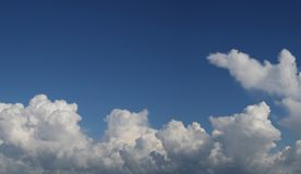 Clouds in sky. Fluffy white clouds in a blue sky Stock Photo