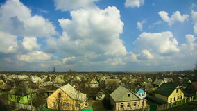 Clouds in the Sky Moving over the Houses in the City. Time Lapse stock video footage