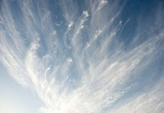 Wind swept Clouds in the sky stock image