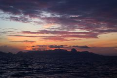 The clouds and purple red sky before sunrise in the ocean. The clouds and the sky with red purple before sunrise in the ocean Stock Photo