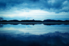 Clouds sky reflection over lake 2 Royalty Free Stock Photo