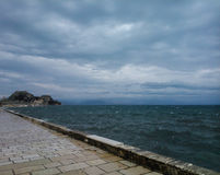 Clouds, sky, sea and the old fortress of Corfu. In Greece a great travel destination Stock Image