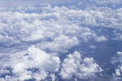 clouds sky skyscape. view from the window of an airplane flying in the clouds, top view clouds like the sea of clouds sky stock photos