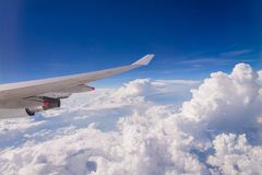 Clouds sky skyscape and Wing of airplane with skyline top view. View from the window of an airplane flying in the clouds, top view clouds like  the sea of Royalty Free Stock Images