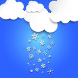 Clouds in sky snowing different snowflakes. White clouds in blue sky snowing different snowflakes Stock Photos