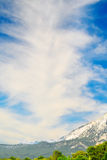 Clouds, sky and splendid mountains. Stock Photography