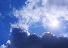 Clouds, sky and sun. Sun and clouds against blue sky background Royalty Free Stock Photo