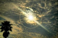 Clouds in the sky. Sun beams through the clouds on a cloudy day royalty free stock photography