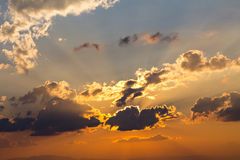 Clouds and sky with sun ray silhouetted. On evening Stock Image